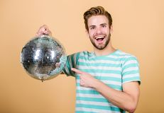 How about party. Handsome man hold disco ball. Disco dances night club. Retro music. Guy inviting you at party. Thousand royalty free stock images