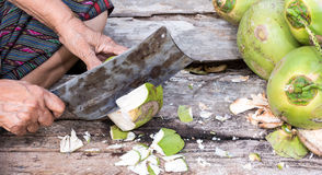 How peeled Coconuts to eat Stock Image