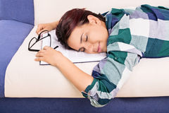 How this read makes me sleep. Young girl fell asleep while studying Stock Image