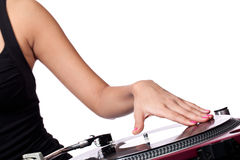 This is how it's done. A female hand queuing up a record on a turntable Stock Photography