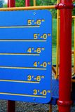How Tall You Are. Colorful childhood measuring pole in the playground equipment Royalty Free Stock Photography