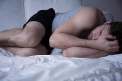 How to beat insomnia. Man trying to beat insomnia and other sleep disorders stock images