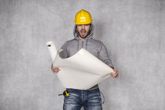 How to build. Yellow helmet on his head Royalty Free Stock Image