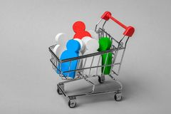 How to choose the right employees. What employees are needed. Purchase of personnel. The shopping trolley and people in it. Concept stock images