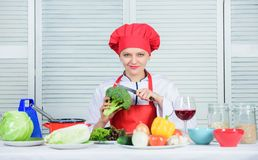 How to cook broccoli. Turn broccoli into favorite ingredient. Broccoli nutrition value. Raw food diet. Woman. Professional chef hold raw broccoli vegetable royalty free stock images