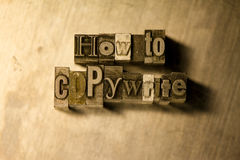 How to copywrite - Metal letterpress lettering sign. Lead metal  typography text on wooden background Stock Photos