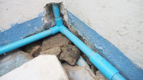How to DIY to install the 3 way joint PVC water pipe. Concept service industry royalty free stock photography