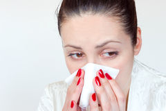 How to fight colds and low immunity. The young woman is cold and holding a handkerchief,  photography Royalty Free Stock Photo