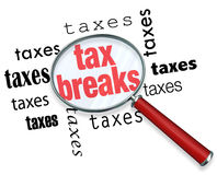 How to Find Tax Breaks - Magnifying Glass. A magnifying glass hovering over the word tax breaks, symbolizing the advice and tricks that an accountant can use to Stock Images