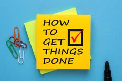 How To Get Things Done Concept. How To Get Things Done written on note and marker pen. Business Concept. Top view stock photos