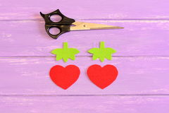 How to hand sew a children toy strawberry. Step. Tutorial. Parts cut from red and green felt in the shape of strawberries Royalty Free Stock Images