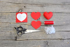 How to hand sew a felt heart for Valentine's day. Tutorial. Red felt heart Royalty Free Stock Photos