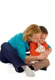 How to hug a bunny. Mother teaching her young child how to hold a bunny (easter theme, isolated royalty free stock images