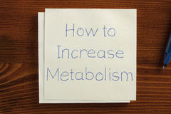 How to increase metabolism handwritten on a note Stock Image