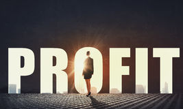 How to increase your profit. Back view of businesswoman standing in light of profit concept Stock Photo