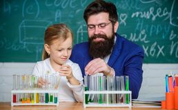 How to interest children study. Fascinating chemistry lesson. Man bearded teacher and pupil with test tubes in classroom. Private lesson. School chemistry stock images