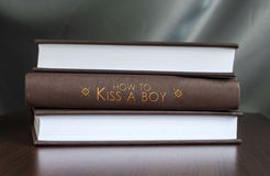 How to kiss a boy. Book concept. Stock Photo