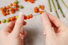 How to make autumn napkin ring with rowan berry - tutorial. Step by step royalty free stock photos