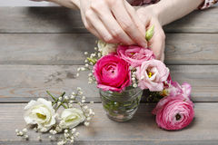 How to make beautiful tiny bouquet of ranunculus and eustoma flo Stock Photo