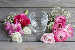 How to make beautiful tiny bouquet of ranunculus and eustoma flo Stock Images