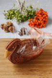 How to make bouquet of flowers in wicker goose. Stock Image