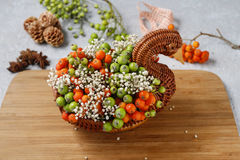 How to make bouquet of flowers in wicker goose. Royalty Free Stock Photo