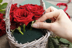 How to make bouquet of roses in wicker basket tutorial Stock Photo