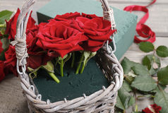 How to make bouquet of roses in wicker basket tutorial Stock Images