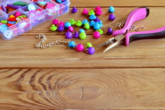 How to make bracelet, fun handicraft for kids. Beautiful way to use buttons. Crafts made with buttons. Diy tutorial. Step Stock Photo