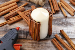 How to make candle decorated with cinnamon sticks tutorial Royalty Free Stock Photos