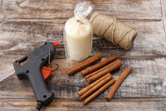 How to make candle decorated with cinnamon sticks tutorial stock photos