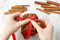 How to make candle decorated with cinnamon sticks - tutorial. How to make candle decorated with cinnamon sticks - step by step, tutorial royalty free stock photography