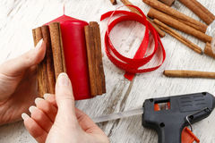 How to make candle decorated with cinnamon sticks - tutorial Royalty Free Stock Image