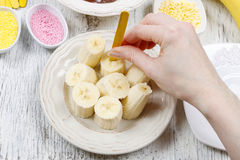 How to make chocolate dipped bananas - step by step Stock Image