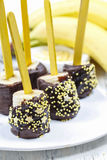 How to make chocolate dipped bananas - tutorial Stock Photos