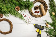 How to make christmas door wreath. The working process. The decorator`s workplace. Top view. Copy space. Still life. Flat lay royalty free stock photos