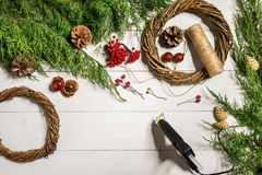 How to make christmas door wreath. The working process. The decorator`s workplace. Top view. Copy space. Still life. Flat lay stock images