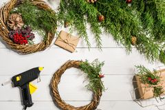 How to make christmas door wreath. The working process. The decorator`s workplace. Top view. Copy space. Still life. Flat lay royalty free stock images