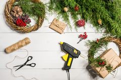 How to make christmas door wreath. The working process. The decorator`s workplace. Top view. Copy space. Still life. Flat lay royalty free stock image
