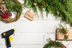 How to make christmas door wreath. The working process. The decorator`s workplace. Top view. Copy space. Still life. Flat lay stock photo