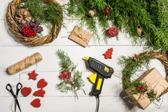 How to make christmas door wreath. The working process. The decorator`s workplace. Top view. Copy space. Still life. Flat lay royalty free stock photography