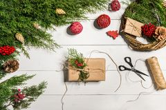 How to make christmas door wreath. The working process. The decorator`s workplace. Top view. Copy space. Still life. Flat lay stock image