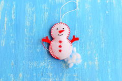 How to make a Christmas felt snowman ornament. Step. Stuff the felt Christmas snowman ornament with hollowfiber. Christmas tree sewing crafts for kids. Blue Stock Images