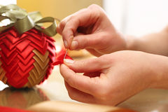 How to make Christmas ornaments with ribbons? Stock Image