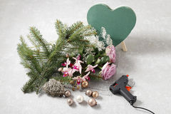 How to make christmas table decoration in heart shape. Tutorial How to make christmas table decoration in heart shape stock photos