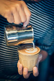 How to make coffee latte art by barista  in vintage color tone Stock Images
