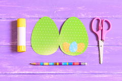 How to make Easter egg greeting card. Step. Training. Children Easter paper craft concept. Top view. Closeup Stock Photography