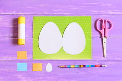 How to make Easter egg greeting card. Step. Tutorial. Kids Easter paper crafts idea. Top view. Closeup Stock Images