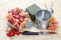 How to make floral arrangement in vintage watering can Royalty Free Stock Photography