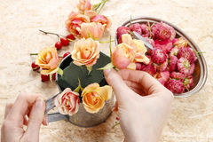 How to make floral arrangement in vintage watering can Stock Photo
